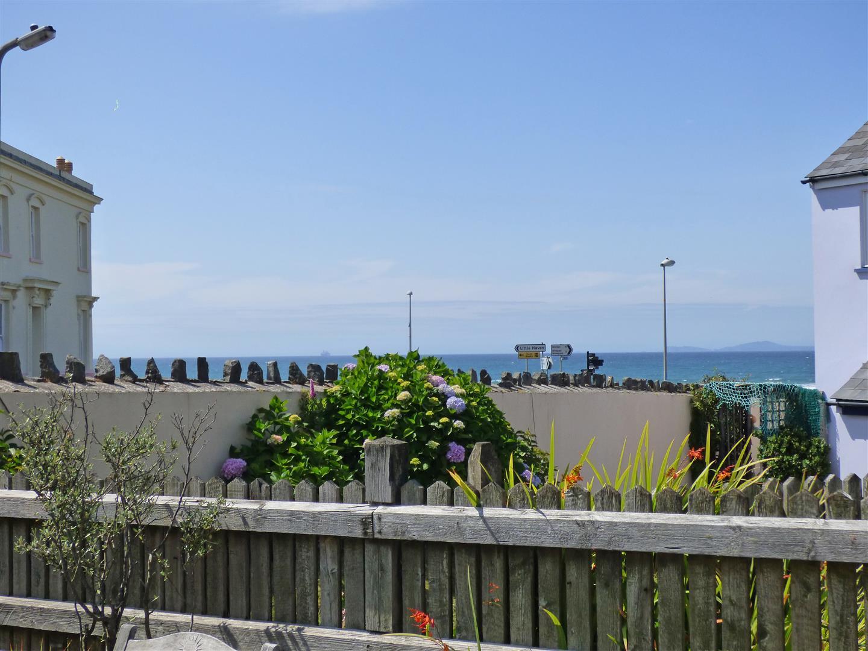 Rear patio with sea views